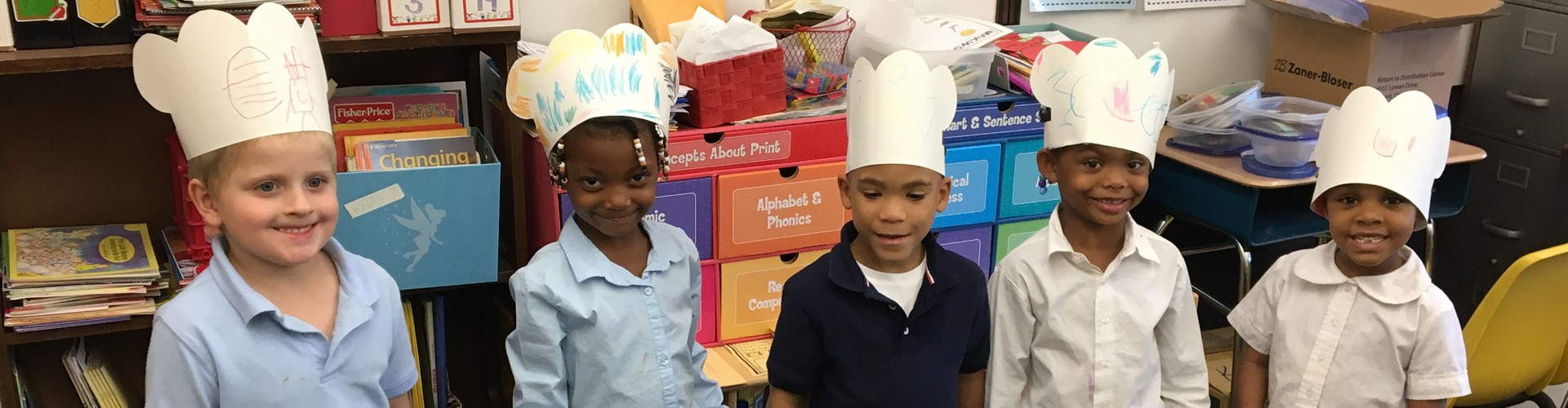 Ms. Weeks Kindergarten Reading Group practices the letter C by making chef hats
